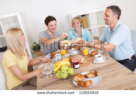 stock-photo-happy-family-with-two-teenage-children-sitting-around-the-table-enjoying-a-healthy-breakfast-112822819.jpg